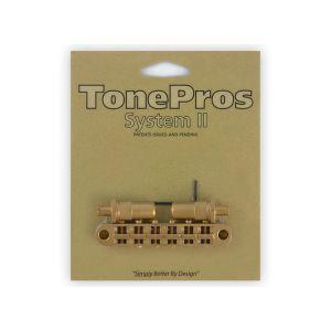 Puente TonePros Tuneomatic T3BT-STG Metric, postes grandes y silletas con muesca (dorado satinado)